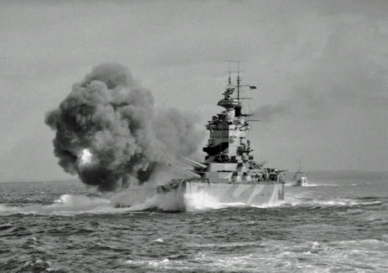 royal navy battleship hms nelson fires a full broadside with her nine 16-inch guns in the mediterranean near gibraltar, 1st august 1942