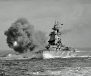 royal navy battleship hms nelson fires a full broadside with her nine 16-inch guns in the mediterranean near gibraltar, 1st august 1942