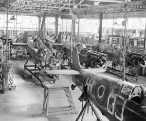 spitfires being produced in a factory during early 1940s.